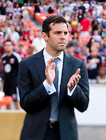 D.C. United head coach Ben Olsen watches his team during a game at RFK Stadium in Washington, DC.  D.C. United tied Toronto FC, 1-1.