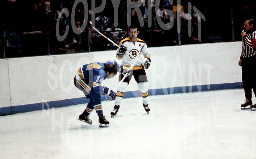 Wayne Maki  St Louis Blues and Ted Green Boston Bruins hockey stick fight in a pre season game in Ottawa Canada 1969 that left Ted Green paralized. Photo copyright Image Communications/photo Ted Grant jr.