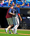 7 March 2009: Washington Nationals' third baseman Jose Castillo is escorted back to the dugout after injuring his arm during a Spring Training game against the New York Mets at Tradition Field in Port St. Lucie, Florida. The Nationals defeated the Mets 7-5 in the Grapefruit League matchup. Mandatory Photo Credit: Ed Wolfstein Photo