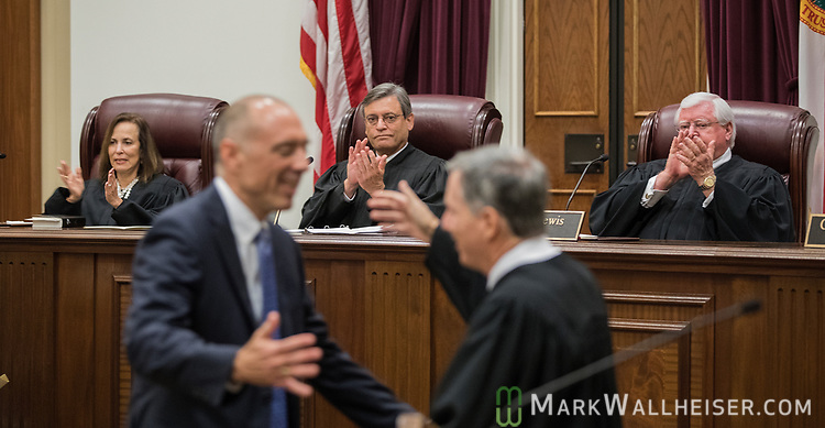 Florida Supreme Court justices applaud during the investiture of the Honorable Alan Lawson as the 86th Justice of The Supreme Court of Florida in Tallahassee, Florida