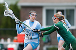 20110405 - Medford/Somerville, Mass. -  Tufts midfielder Eliza Halmo (A14) tries to break past a Babson defender at Bello Field on April 5, 2011. (Kelvin Ma/Tufts University)
