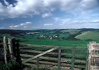 Farm gate and fields in Devonshire, England, UK