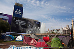 Protest camp at Placa de Catalunya, Barcelona, Spain. Behind is a Hyundai advertisement, which reads &quot;Still believe that animals do not love? Another way of thinking is possible&quot;.. Behind is a Hyundai advertisement, which reads &quot;Still believe that animals do not love? Another way of thinking is possible&quot;. The square has been relatively quiet since police attacked and beat protestors on May 27 2011.