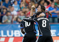 Alan Gordon of Earthquakes and Chris Wondolowski of Earthquakes celebrate with Simon Dawkins of Earthquakes after Dawkins scored a goal in the first half of the game against Chivas USA at Buck Shaw Stadium in Santa Clara, California on September 2nd, 2012.   San Jose Earthquakes defeated Chivas USA, 4-0.