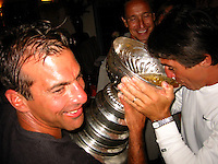 24 August 2002: Actor, Director & Producer  Tony Danza drinks from the NHL Stanley Cup with Detroit Red Wings hockey player CHRIS CHELIOS in Los Angeles. .