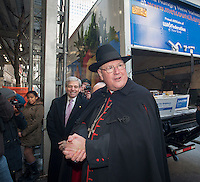 "Timothy Michael Cardinal Dolan of the Archdiocese of NY  joins representatives of the UJA-Federation and Catholic Charities to promote the 2nd annual ""Feeding our Neighbors: An Interfaith Response"" in front of St. Patrick'sCathedral in New York on Sunday, January 27, 2013. The campaign is an interfaith effort between Catholic and Jewish social service organizations to collect food donations to re-fill the sorely depleted food pantries, meal programs  and soup kitchens that serve those in need.  (© Richard  B. Levine)"