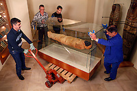"GEORGES LABIT MUSEUM, TOULOUSE, FRANCE - MARCH 03 - EXCLUSIVE : A general view of the Egyptian mummy encased in a sarcophagus moved by warehousemen on March 3, 2009 in the Georges Labit Museum, Toulouse, France. The Egyptian mummy arrived in Toulouse in 1849, encased in a sarcophagus labelled ""In-Imen"" from the 7th or 8th century BC. It is preserved at the Labit Museum since 1949. The mummy has been the subject of a very rare tissue sampling operation to determine its datation.  (Photo by Manuel Cohen)"