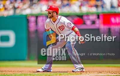 25 July 2013: Washington Nationals outfielder Bryce Harper takes a lead off first during a game against the Pittsburgh Pirates at Nationals Park in Washington, DC. The Nationals salvaged the last game of their series, winning 9-7 ending their 6-game losing streak. Mandatory Credit: Ed Wolfstein Photo *** RAW (NEF) Image File Available ***