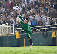 Galaxy goalie Josh Saunders (12) attempts to block a shot on goal during the second half of the friendly game between LA Galaxy and Real Madrid at the Rose Bowl in Pasadena, CA, on August 7, 2010. LA Galaxy 2, Real Madrid 3.