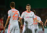 FUSSBALL  DFB POKAL       SAISON 2012/2013 Jahn Regensburg - FC Bayern Muenchen  20.08.2012 Thomas Mueller mit  Bastian Schweinsteiger (v. li., FC Bayern Muenchen)