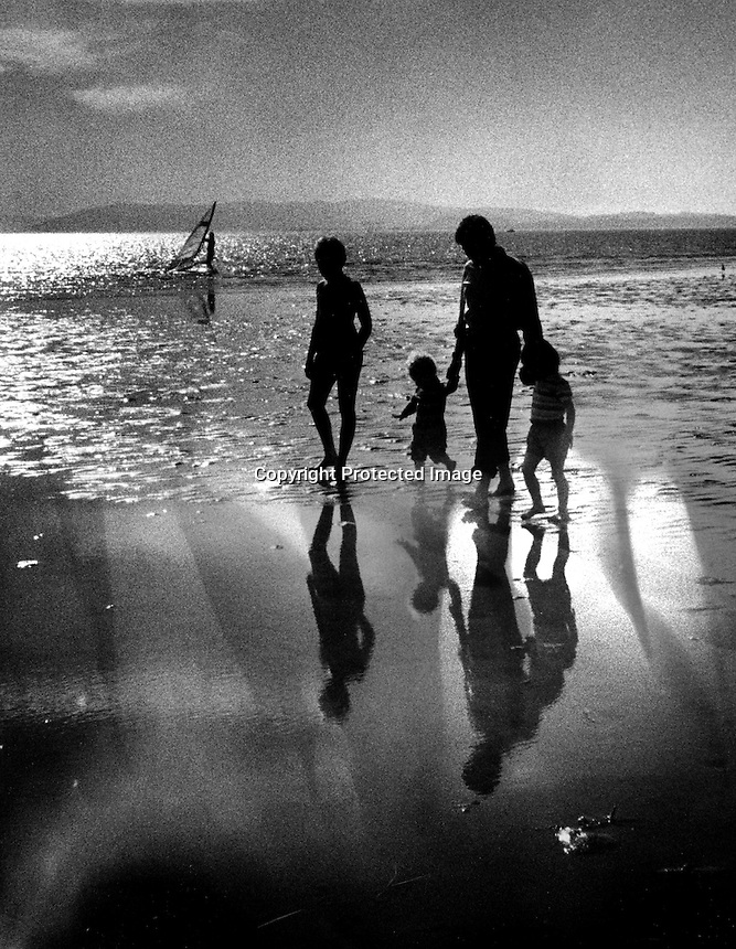 Family walking on the beach at Alameda,Ca South Shore of San Francisco Bay.(photo/Ron Riesterer)
