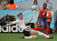 JUNE 9, 2006: Munich, Germany: Costa Rican forward (9) Paulo Wanchope crosses the ball past German defender (17) Per Mertesacker during the World Cup Finals in Munich, Germany. Germany defeated Costa Rica, 4-2.