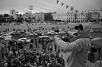Tripoli, Libya, March 15, 2011.A very small crowd, some of them obviously bussed in, celebrates in Green Square the news heralded by Libyan State media that the city of Adjabya would have been re-captured by pro - Khaddafi forces.