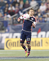 New England Revolution midfielder Kelyn Rowe (11) traps the ball. In a Major League Soccer (MLS) match, the New England Revolution (blue) defeated Chicago Fire (red), 1-0, at Gillette Stadium on October 20, 2012.