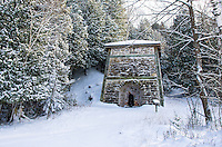 A fresh blanket of snow covers the trees and the old limestone kiln building. Fayette State Park, Garden Peninsula
