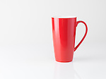 Red tall tea mug isolated on white background