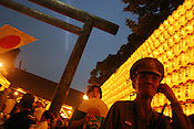 "Visitors to Yasukuni Jinja Shrine for 'Mitama Matsuri', Tokyo,  Japan, on Saturday, July. 16th 2005. The Mitama Matsuri is an annual festival, meaning ""Festival To Enshrine the Spirit of the Dead"". Yasukuni Shrine is controversially knwn as Japans shrine to the war dead, including controversially, the spirits of Class 'A' war criminals."