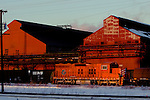 In the last light of the day, a short Elgin, Joliet & Eastern freight train picks its way through the large Arcelor/Mittal steel mill at East Chicago, IN.