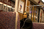 Woman rides the metro in Berlin, Germany