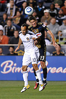 Landon Donovan (10) of the Los Angeles Galaxy and Kyle Nakazawa (13) of the Philadelphia Union go up for a header. The Philadelphia Union  and the Los Angeles Galaxy played to a 1-1 tie during a Major League Soccer (MLS) match at PPL Park in Chester, PA, on May 11, 2011.