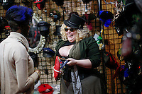 New York City, NY. 10 October 2014. A vendor sells a hat while she attend the 2014 New York Comic Con fair at the Jacob Javits Center. Photo by Kena Betancur/VIEWpress