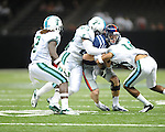 Ole Miss quarterback Bo Wallace (14) vs. Tulane's Logan Hamilton (63) and Tulane's Ryan Travis (10) in the first half at the Mercedes-Benz Superdone in New Orleans, La. on Saturday, September 22, 2012. Ole Miss won 39-0...