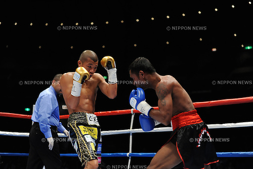 (L-R) Koki Kameda (JPN), Nouldy Manakane (INA),.APRIL 4, 2012 - Boxing :.Koki Kameda of Japan and Nouldy Manakane of Indonesia during the WBA bantamweight title bout at Yokohama Arena in Kanagawa, Japan. (Photo by Mikio Nakai/AFLO)