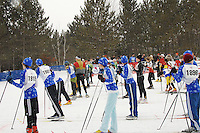 Cross country skiers line up to start the race during Badger State Winter Games at Nine Mile Forest in Wausau on Sunday