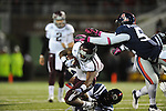 Texas A&amp;M running back Ben Malena (1) is tackled by Ole Miss linebacker Denzel Nkemdiche (4) and Ole Miss linebacker Mike Marry (52) in Oxford, Miss. on Saturday, October 6, 2012. Texas A&amp;M won 30-27...