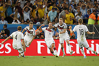 Mario Gotze of Germany celebrates scoring a goal with team mates after making it 1-0