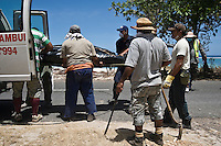 A body found by police officers and volunteers as they searched through debris for missing persons following the tsunami. More than 170 people died when a tsunami triggered by an 8.3 magnitude earthquake hit Samoa and neighbouring Pacific islands on 29/09/2009. Samoa (formerly known as Western Samoa)..