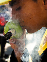 A teen smokes marijuana during a demonstration in support for legalization of marijuana in Bogota, May 4, 2013. Photo by Freddy Builes / VIEWpress.