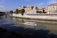 Boat on River Tiber.A view of the Church of thel Sacro Cuore del Suffragio with an excursion boat on the Tiber River in Rome.