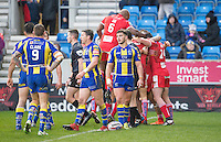 Picture by Allan McKenzie/SWpix.com - 04/03/2017 - Rugby League - Betfred Super League - Salford Red Devils v Warrington Wolves - AJ Bell Stadium, Salford, England - Warrington's dejection shows as Salford celebrate their victory over them.