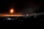 "Syria, Zabadani. Heavy shelling on the restive village of Zabadani. At night Al Assad army shot ""flares"" to localise Free Syrian Army positions on August 8, 2012.  ALESSIO ROMENZI"