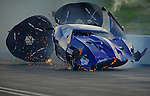 Jun. 18, 2011; Bristol, TN, USA: NHRA pro mod driver Roger Burgess crashes alongside Kenny Lang during eliminations at the Thunder Valley Nationals at Bristol Dragway. Mandatory Credit: Mark J. Rebilas-