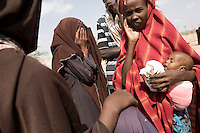 Kenya - Dadaab – 21st July 2011. Refugees who arrived last night or this morning are queing at Dagahaley registration center in order to receive cooking tools and their first food ration.