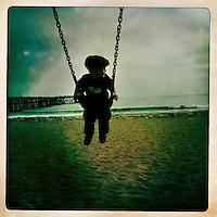 Ventura, California, May 6, 2011 - Finn Maddox Peveto plays on the beach playground at the Ventura Pier.