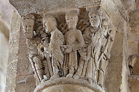Carved capital depicting the arrest and trial of St Foy, with pro consul Dacien and a soldier leading her to the judge, in the Abbatiale Sainte-Foy de Conques or Abbey-church of Saint-Foy, Conques, Aveyron, Midi-Pyrenees, France, a Romanesque abbey church begun 1050 under abbot Odolric to house the remains of St Foy, a 4th century female martyr. This capital was possibly carved by the Master of the Tympanum. The church is on the pilgrimage route to Santiago da Compostela, and is listed as a historic monument and a UNESCO World Heritage Site. Picture by Manuel Cohen