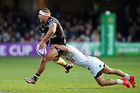 Robbie Fruean of Bath Rugby looks to offload the ball after being tackled. European Rugby Challenge Cup match, between Bath Rugby and Pau (Section Paloise) on January 21, 2017 at the Recreation Ground in Bath, England. Photo by: Patrick Khachfe / Onside Images