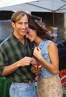 Couple enjoying being at an outdoor market together