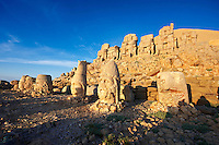 Pictures & Images of the statues of around the tomb of Commagene King Antochus 1 on the top of Mount Nemrut, Turkey. Stock photos & Photo art prints. In 62 BC, King Antiochus I Theos of Commagene built on the mountain top a tomb-sanctuary flanked by huge statues (8–9 m/26–30 ft high) of himself, two lions, two eagles and various Greek, Armenian, and Iranian gods. The photos show the broken statues on the  2,134 m (7,001 ft)  mountain. 4
