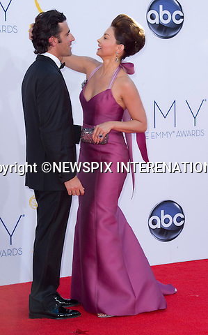 "ASHLEY JUDD AJDUSTS HUSBAND DARIO's LOOKS - 64TH PRIME TIME EMMY AWARDS.Nokia Theatre Live, Los Angelees_23/09/2012.Mandatory Credit Photo: ©Dias/NEWSPIX INTERNATIONAL..**ALL FEES PAYABLE TO: ""NEWSPIX INTERNATIONAL""**..IMMEDIATE CONFIRMATION OF USAGE REQUIRED:.Newspix International, 31 Chinnery Hill, Bishop's Stortford, ENGLAND CM23 3PS.Tel:+441279 324672  ; Fax: +441279656877.Mobile:  07775681153.e-mail: info@newspixinternational.co.uk"