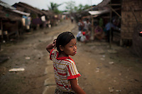 A child walks through the Hlaing Thaya slum district of Yangon.