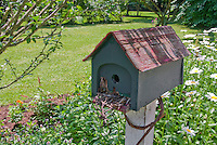 Bird house on post in garden