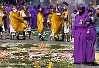 A parade of the faithful during the Procesión de Jesús Nazareno de La Caída from Iglesia San Bartolomé Becerra in Antigua, Guatemala. Each weekend during Lent features a procession by a different church, culminating in Semana Santa, or Holy Week, one of the largest Easter commemorations in Latin America.