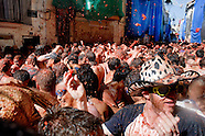 Thousands of people throw tomatoes on the street during La Tomatina festival in Bunol, Spain, 31 August 2006. La Tomatina is a tomato fight held annually in the town of Bunol, close to Valencia. Approximately 40,000 people from all over the world arrive to fight in the battle in which about 50 tons of over-ripe tomatoes are thrown in the street. During the one hour battle everybody fights everybody by throwing squashed tomatoes. The origin of this event is unknown but the Tomatina fights have been recorded since 1945.