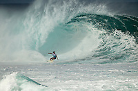 North Shore/Oahu/Hawaii HONOLULU (Dec. 8, 2011) Dane Reynolds (USA).-- Detonating 15- to 20-foot waves at Banzai Pipeline got the blood pumping on the beach and spilling in the water for day one of the Billabong Pipe Masters, and a spirited demonstration of perfect surfing by 19-year-old John John Florence (Hawaii) got the emotions flowing. A maximum capacity crowd turned out to see what the North Shore's rising star could do on the biggest swell of the winter and they weren't disappointed. Florence showed why he is the leader of the Vans Triple Crown of Surfing ratings, presented by Rock Star Energy Drink, picking up where he left off after winning the Vans World Cup at Sunset Beach last week. The Billabong Pipe Masters is the third and final jewel of the Vans Triple Crown..Scored on their best two waves in each 40 minute heat, the majority of surfers struggled to lock in two solid scores in the deadly, barreling waves. But Florence and a handful of Pipe locals rallied with incredible performances that saw them streak ahead. Florence notched up not two, but five great tube rides in his heat. His top two totaled 18.16 out of 20, including a perfect 10 for two deep and successful tube rides on a single wave. . Photo: joliphotos.com
