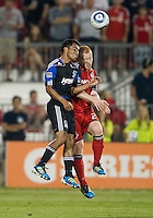 27 August 2011: San Jose Earthquakes midfielder Rafael Baca #30 and Toronto FC defender Richard Eckersley #27 in action during a game between the San Jose Earthquakes and Toronto FC at BMO Field in Toronto..The game ended in a 1-1 draw.