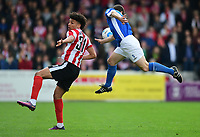 Lincoln City's Lee Angol vies for possession with Macclesfield Town's George Pilkington<br /> <br /> Photographer Chris Vaughan/CameraSport<br /> <br /> Vanarama National League - Lincoln City v Macclesfield Town - Saturday 22nd April 2017 - Sincil Bank - Lincoln<br /> <br /> World Copyright &copy; 2017 CameraSport. All rights reserved. 43 Linden Ave. Countesthorpe. Leicester. England. LE8 5PG - Tel: +44 (0) 116 277 4147 - admin@camerasport.com - www.camerasport.com